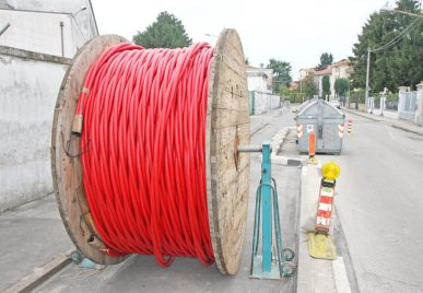 17661334 - spool of cable and fiber optics in the road during the outdoor and underground laying
