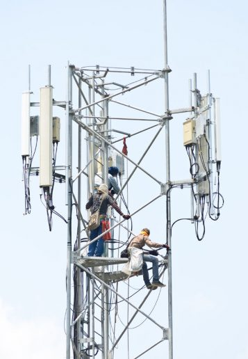 31073309 - technician working on communication towers